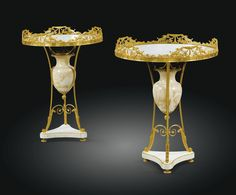 A PAIR OF RUSSIAN GILTBRONZE, WHITE MARBLE AND ALABASTER GUERIDONS, THE TOPS, FRENCH, EARLY 19TH CENTURY