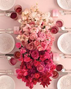 Ombre Centerpiece  In this floral version of the popular fabric print, light-colored sweet peas, hyacinths, and nerines gradiate into a darker cluster of fuchsia peonies, ruby fringe tulips, and raspberry cyclamens.