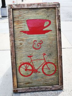 Cool sign.....love the distressed wood and pop of red