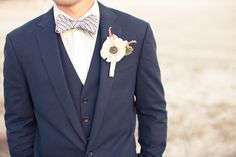 anemone bout and a spiffy bow tie too   Photography by laurenpiper.com, Floral Design by http://redmansteeleflorist.net