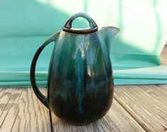 Vintage Blue Mountain Pottery Coffee or Tea Pot. Rare Shape. Collectible. Turquoise Brown Glaze.. $30.00, via Etsy.