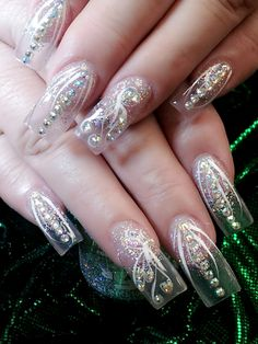 Clear nails with white, glitter and rhinestone accents