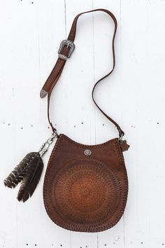 Etched leather & feathers. Lovely. Mandala Saddle Bag by Spell Designs. (This would make a great medicine bag...CW)