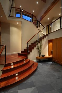 sleek-laminate-floor-and-stairs-mixed-with-gray-ceramic-floor-tile-in-a-cream-waterfront-house-design