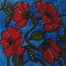 Poppies in glass