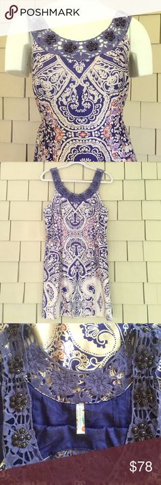 ‼️SALE‼️ FP Paisley Dress with Beaded Neckline Flowers of purple beads adorned the neckline front and back. Darts at bodice. Lined. Side hidden zipper with hook-and-eye closure. Sateen cotton is silky smooth and very comfortable. Worn to a couple baby/wedding showers and just doesn't me fit anymore. In excellent condition. Make me an offer! Free People Dresses Mini