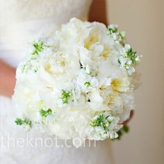 An elegant and sophisticated all-white bouquet of peonies and stock.