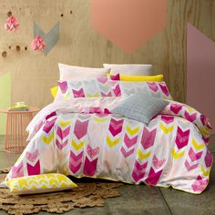 A dynamic arrow print that combines bright pinks and yellow with pale grey, peach and white. The euro pillowcase features an abstract peach floral and the cushion covers echo the print featured in the quilt cover set.