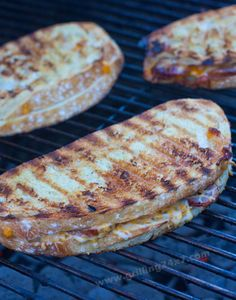 Grilling #grilledcheese sandwiches on the charcoal grill with sliced bratwurst and jalapeños #grillingrecipes - grilling24x7.com
