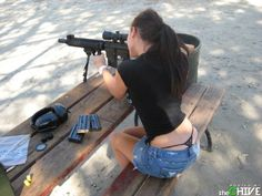 .nothing is hotter than a sexy girl with a gun!
