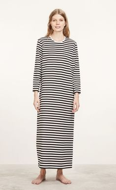 You'll want to stay in this long, comfy cotton nightdress long after you've woken up. The dress has a classic black and white Tasaraita pattern, a round ribbed neckline, long sleeves and a slightly widening cut to the hemline just above the ankle. Marimekko, Unisex, Night Gown, Modern Design, Cold Shoulder Dress, Gowns, Black And White, Classic, Womens Fashion