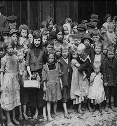1910 - London dockers children, living in rat infested slums, surviving on discarded fish heads and tails from Billingsgate Fish Market. Their Fathers went on strike for a minimum wage of 6d per hour (£1.50 per week)