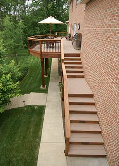 If your deck includes a long stringer of stairs, it's helpful to break up the design with landings.