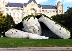 Giant Ogre Sculpture Rips Out of Lawn in Budapest. Ervin Loránth Hervé budapest sculpture
