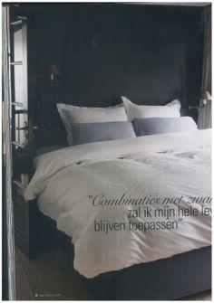 Slaapkamer met wit, grijs en rustgevend zwart