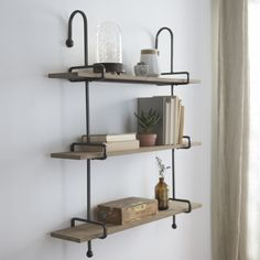 Keep your decor polished and simple with the 'Wooden Slat Pipe Shelf' from Kirkland's. Easily incorporate this piece into your home today!