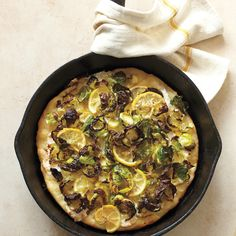 Brussels sprouts make for a crispy, chewy pizza topping. Lemon slices, ever so slightly caramelized, add zing.