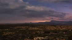 A static day to night timelapse of a rocky landscape with Cederberg Mountains seen from Kaggakamma Nature Reserve as night falls on a moonlit landscape. Nature Reserve, Stock Footage, African, Mountains, Sunset, Landscape, Night, Day, Travel