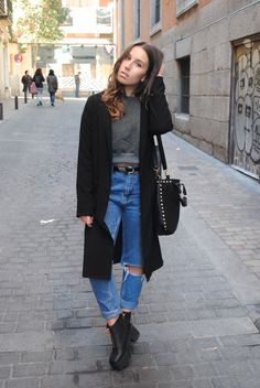 Shop this look on Lookastic: https://lookastic.com/women/looks/coat-cropped-sweater-boyfriend-jeans-ankle-boots-crossbody-bag/7341 — Black Coat — Blue Ripped Boyfriend Jeans — Black Suede Crossbody Bag — Black Chunky Leather Ankle Boots — Dark Green Cropped Sweater