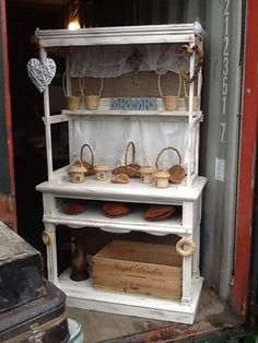 Old table converted to vintage sweet stall