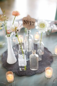 With placemat and different size bottles with one flower