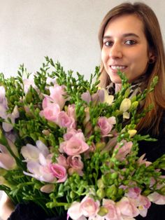 Natalie at the studio preparing the baby pink freesias for a shoot www.sandrakaminski.com