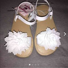 Adorable girls white sandals SUPER ADORABLE girls white one strap sandals with white flower accent. Brand new and so perfect for the summer! Shoes Sandals