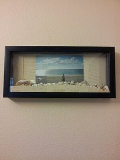 Photo of my boyfriend on the beach at the Bahamas with sand that's I took from that beach :) put it in a shadow box and hang it!