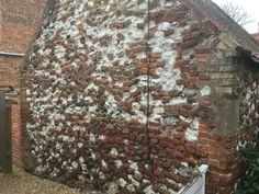 Randomly Brick and flint wall off Station Road, Burnham Market, Norfolk. UK PE31 8 HA 18th March 2017.
