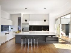 kitchen designs with island bench and pendant lighting. Like the grey island but not the black splash back.