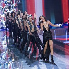 Time to do the Locomotion! Selena leads her backing dancers in a routine