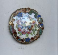 Antique enamel button with birds, flowers, ornate border!