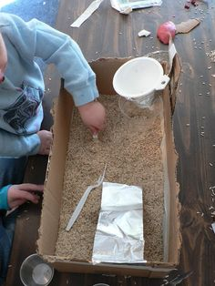Sensory Box for cold winter days - AKA a box of rice for the kids to play in and they LOVE it. Too easy