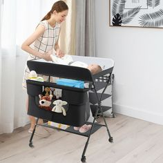 """This baby diaper changing table has 3-level adjustable height from 38"""" to 40"""" which offers a suitable position to change diapers, do massage as well as change clothes for babies. It will greatly free parents' waists and prevent back aches from bending. Made of solid iron pipe frame and durable 600D canvas, this changing table has great stability and can be used for a long time. Besides, equipped with various and large storage space, it will keep everything tidy and neat in the home. Newborn Nursery, Nursery Organization, Iron Pipe, Bending, Baby Registry, Diapers, Stability, Bassinet, Storage Spaces"""