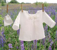 Simple and stylish. Pure white, prewashed (for a shrinkage prevention), 100% Lithuanian linen baby boy or baby girl jacket. Two white buttons front closure - easy to dress up. Perfect warm...