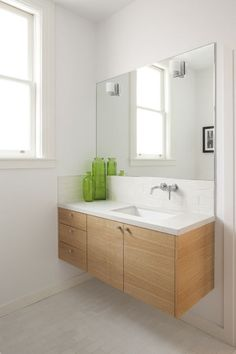 I want all my storage furniture to be wall hung - so much cleaner, less on the floor!  modern bathroom by McElroy Architecture, AIA
