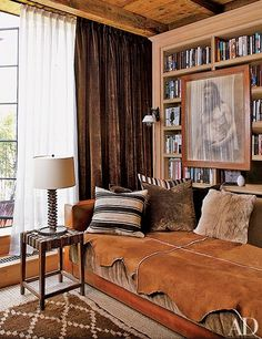 Writer Brad Goldfarb and his partner, Alfredo Paredes—executive vice president and chief retail creative officer at Ralph Lauren—collaborated with architect Michael Neumann on the renovation of their Manhattan duplex. The daybed in the study is clad in leather and silk velvet, both by Ralph Lauren Home.
