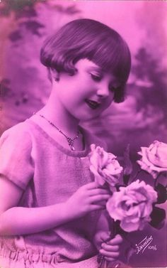 Adorable little girl with bobbed hair, vintage 1920s postcard: