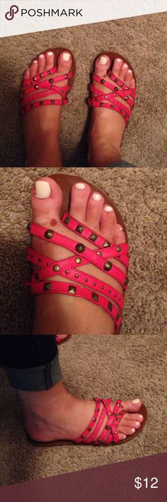 Volcom sandals Super cute volcom sandals! The color is a red-ish-pink color. More red than pink. Different types of studs across the five straps. Very comfortable! (P.s. Don't mind my spotty spray tan ✌️) Volcom Shoes Sandals