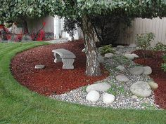 like the combination of the rocks & chips as a wavy line. want to do this in the flower beds.