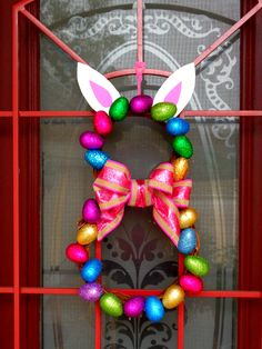 Easter wreath I made using wood rings and plastic eggs. Ears are foam.