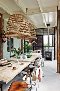 Dining rooms don't have to be formal or stuffy. We're all about a boho chic dining space, too! Check out these 40 dining rooms that master boho interior design. For more dining room design ideas, go to Domino! Rustic Table And Chairs, Table Lamps, Basket Lighting, Lighting Ideas, Decor Scandinavian, Farmhouse Remodel, Farmhouse Style, City Farmhouse, Farmhouse Interior