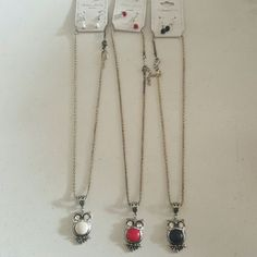 Set of 3 Owl Theme Earrings and Necklace Sets Metal is silver color and reconstructed stone is color white, red,black. Size of necklace is 22 inches long with extender plus pendant, earrings are drop and dangle  1 inch in size. Jewelry Necklaces