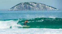 A surfer rides the waves off Rio de Janeiro. It was not me!
