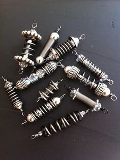 Idea. Beads made from hardware store springs and fuses.