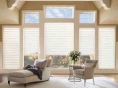 Window treatment from @shadetrendsfl lets in a soft glow in this neutral living room. #luxeFL
