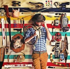 "Kiel James Patrick and his Hudson's Bay Blanket and ""toys."""