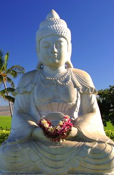 A Buddha in tropical paradise by the ocean on the Big Island of Hawaii.