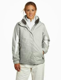 Tracy in a light grey with white trim on her jacket.