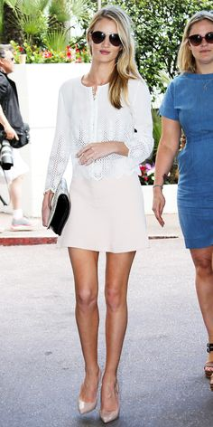 In Cannes, Rosie Huntington-Whiteley took in the view wearing a pastel Chloe skirt, embroidered cotton blouse, python clutch and patent leather Brian Atwood pumps.